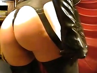 Girl in latex mask on webcam