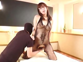 Nerdy Japanese brunette babe oiled up increased by fucked on every side fishnets