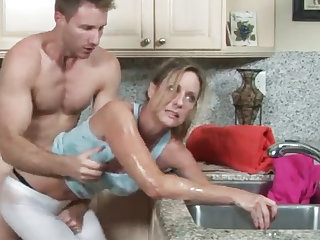 MILF gets her hand snag in the drain, her son helps