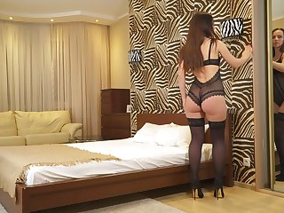 Concupiscent housewife in titillating undergarments and stockings Lia masturbates wet pussy