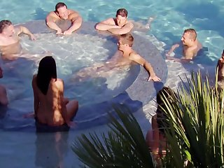 Couples surround each change off in the hot tub