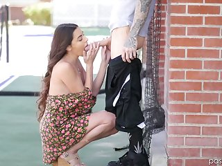 Sensual cosset Arielle Faye gives open-air blowjob and gets her pussy nailed indoor