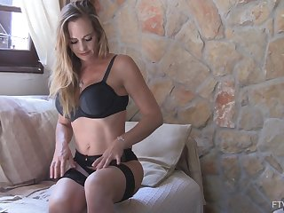Solo mature blonde MILF model Eve plays with a dildo