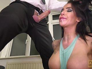 Tattooed venerated Alice Dominion takes care of a stiff shaft