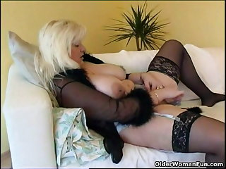 Chubby housewife in stockings plays with far-out sex toy