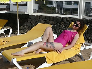 Hot and slutty bikini girl Bea Triss takes sexy poses on the deck chair