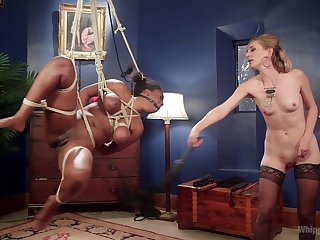 Busty ebony Lisa Tiffian is capably tied and and fisted wide of hot Mona Wales