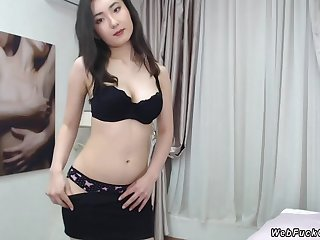 Asian babe strips black skirt and then lingerie and showing her natural big tits