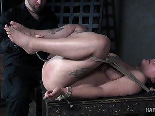 Tied helter-skelter in a crazy pose bitch Ella Jane deserves some cunt masturbation