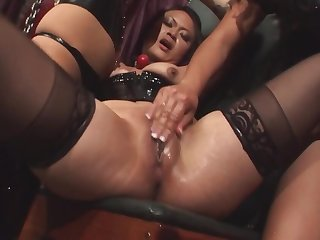 Chained up girl is being dominated by four lesbian chicks